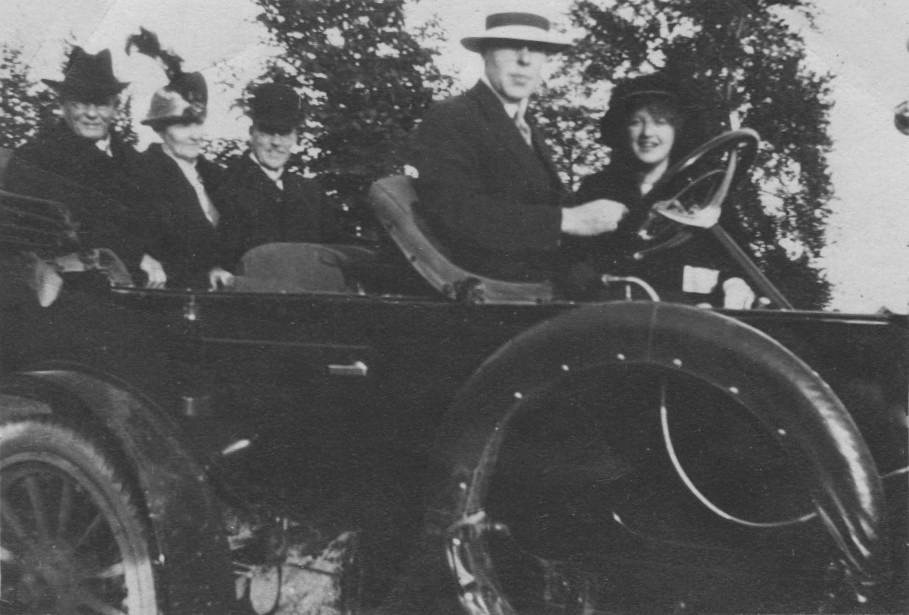Photo of Price family in a 1911 Russell Motor Car